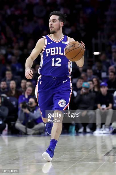J McConnell of the Philadelphia 76ers dribbles the ball against the San Antonio Spurs at Wells Fargo Center on January 3 2018 in Philadelphia...