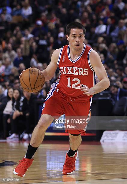 J McConnell of the Philadelphia 76ers dribbles the ball during the first half of an NBA game against the Toronto Raptors at the Air Canada Centre on...
