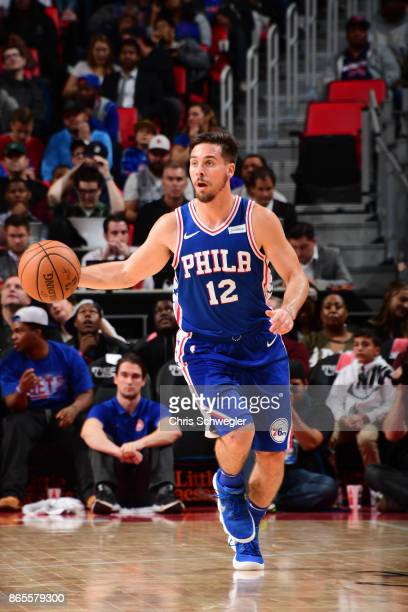 J McConnell of the Philadelphia 76ers drives against the Detroit Pistons on October 23 2017 at Little Caesars Arena in Detroit Michigan NOTE TO USER...