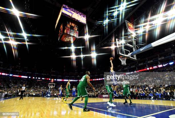 TJ McConnell of the Philadelphia 76ers drives for the basket during the NBA game between Boston Celtics and Philadelphia 76ers at The O2 Arena on...