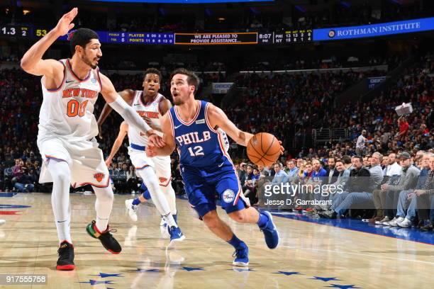 J McConnell of the Philadelphia 76ers drives to the basket against the New York Knicks at Wells Fargo Center on February 12 2018 in Philadelphia...