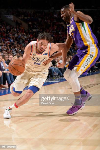 J McConnell of the Philadelphia 76ers drives to the basket against the New Orleans Pelicans at Wells Fargo Center on February 9 2018 in Philadelphia...