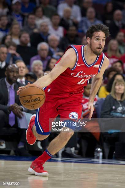 J McConnell of the Philadelphia 76ers drives to the basket against the Miami Heat at the Wells Fargo Center on February 14 2018 in Philadelphia...