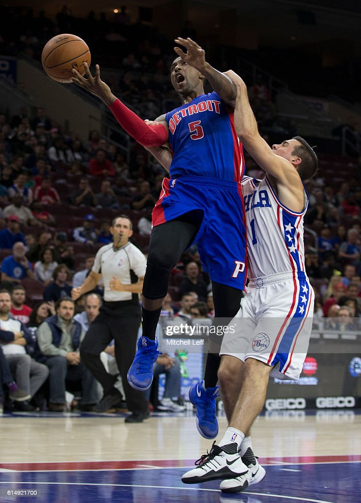 T.J. McConnell #1 of the Philadelphia 76ers fouls Kentavious Caldwell-Pope #5 of the Detroit Pistons in the second half at Wells Fargo Center on October 15, 2016 in Philadelphia, Pennsylvania. The Pistons defeated the 76ers 97-76.