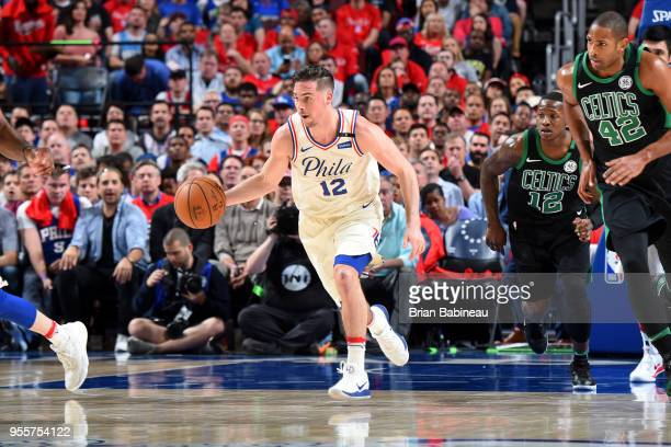J McConnell of the Philadelphia 76ers handles the ball against the Boston Celtics in Game Four of the Eastern Conference Semifinals during the 2018...