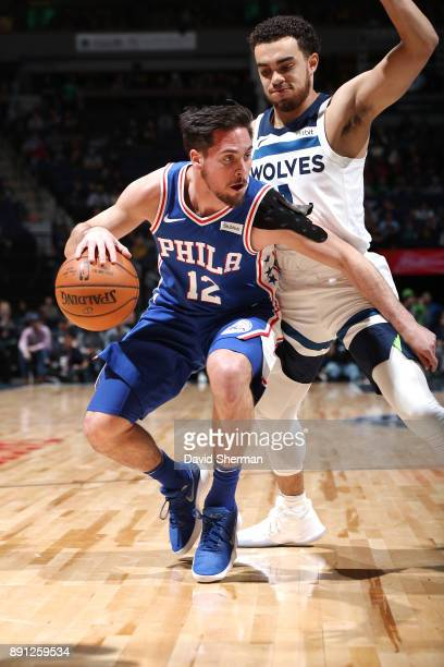 J McConnell of the Philadelphia 76ers handles the ball against the Minnesota Timberwolves on December 12 2017 at Target Center in Minneapolis...