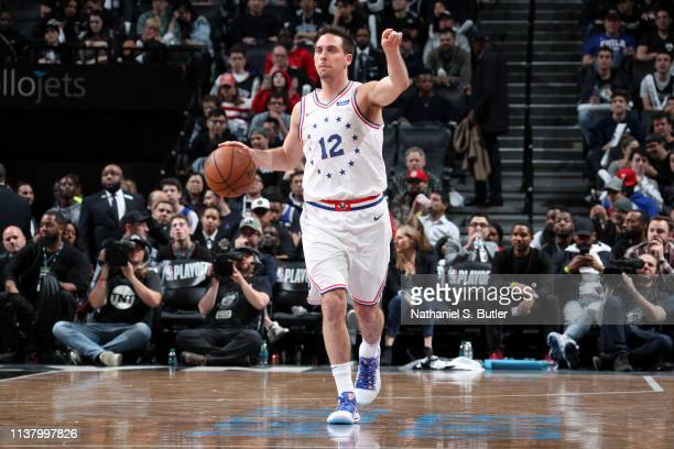 J McConnell of the Philadelphia 76ers handles the ball against the Brooklyn Nets during Game Three of Round One of the 2019 NBA Playoffs on April 18...
