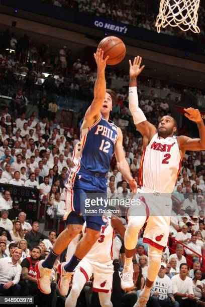 J McConnell of the Philadelphia 76ers handles the ball against Wayne Ellington of the Miami Heat in Game Three of Round One of the 2018 NBA Playoffs...