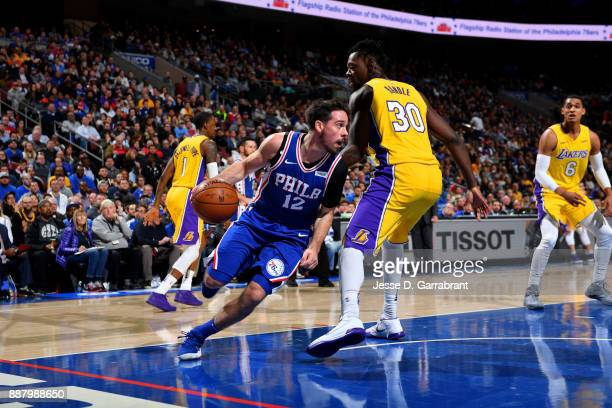 J McConnell of the Philadelphia 76ers handles the ball during the game against the Los Angeles Lakers on December 7 2017 at Wells Fargo Center in...