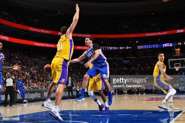 J McConnell of the Philadelphia 76ers passes the ball against the Los Angeles Lakers on December 7 2017 at Wells Fargo Center in Philadelphia...