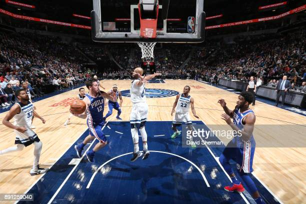 J McConnell of the Philadelphia 76ers passes the ball against the Minnesota Timberwolves on December 12 2017 at Target Center in Minneapolis...