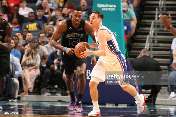 J McConnell of the Philadelphia 76ers passes the ball during the game against the Charlotte Hornets on April 1 2018 at Spectrum Center in Charlotte...