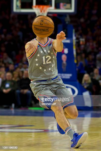 J McConnell of the Philadelphia 76ers passes the ball in the first quarter against the Atlanta Hawks at the Wells Fargo Center on January 11 2019 in...