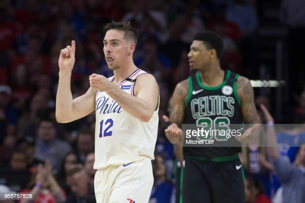 J McConnell of the Philadelphia 76ers reacts in front of Marcus Smart of the Boston Celtics after making a basket and getting fouled in the first...