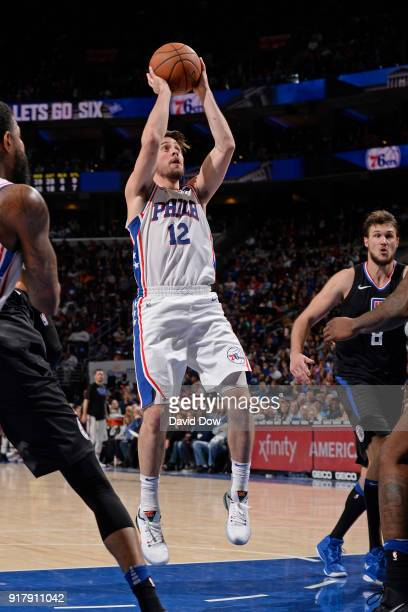 J McConnell of the Philadelphia 76ers shoots the ball against the LA Clippers at Wells Fargo Center on February 10 2018 in Philadelphia Pennsylvania...