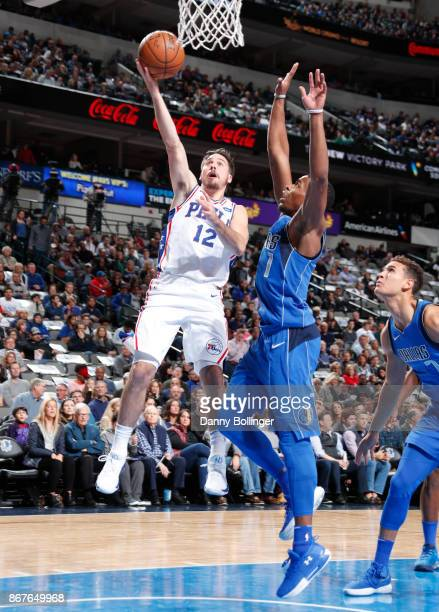 J McConnell of the Philadelphia 76ers shoots the ball against the Dallas Mavericks on October 28 2017 at the American Airlines Center in Dallas Texas...
