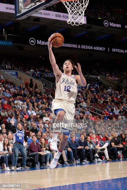 J McConnell of the Philadelphia 76ers shoots the ball during the game against the Milwaukee Bucks on April 11 2018 in Philadelphia Pennsylvania NOTE...