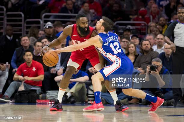 J McConnell of the Philadelphia 76ers steals the ball from James Harden of the Houston Rockets in the first quarter at the Wells Fargo Center on...