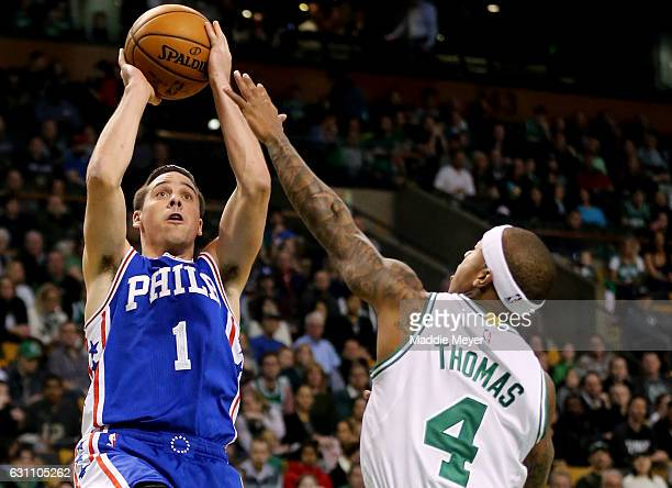 J McConnell of the Philadelphia 76ers takes a shot against Isaiah Thomas of the Boston Celtics during the first half at TD Garden on January 6 2017...