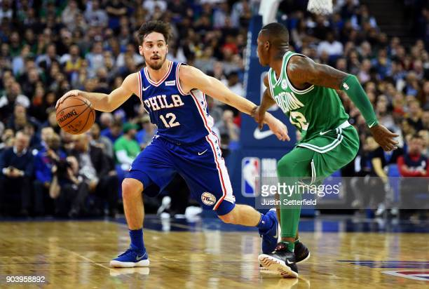 J McConnell of the Philadelphia 76ers takes on Terry Rozier of the Boston Celtics during the NBA game between Boston Celtics and Philadelphia 76ers...