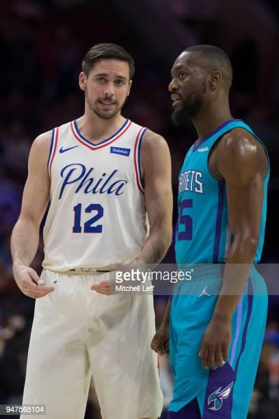 J McConnell of the Philadelphia 76ers talks to Kemba Walker of the Charlotte Hornets at the Wells Fargo Center on March 2 2018 in Philadelphia...