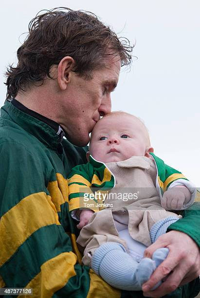 AP McCoy kisses his baby son Archie after his 4000th victory in the 5th race during racing at Towcester racecourse on November 7th 2013 in...