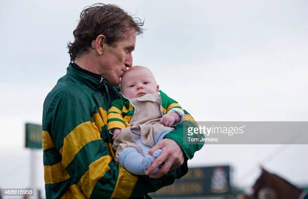 McCoy kisses his baby son Archie just after his 4000th victory in the 5th race during racing at Towcester racecourse on November 72013 in...