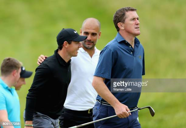 McCoy Pep Guardiolla and Rory Mcilroy speak during the ProAm of the Dubai Duty Free Irish Open at Portstewart Golf Club on July 5 2017 in Londonderry...