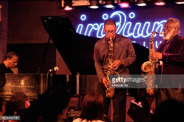McCoy Tyner Quintet performing at Iridium on Tuesday night May 11 2004This imageFrom left McCoy Tyner Ravi Coltrane and Pharoah Sanders