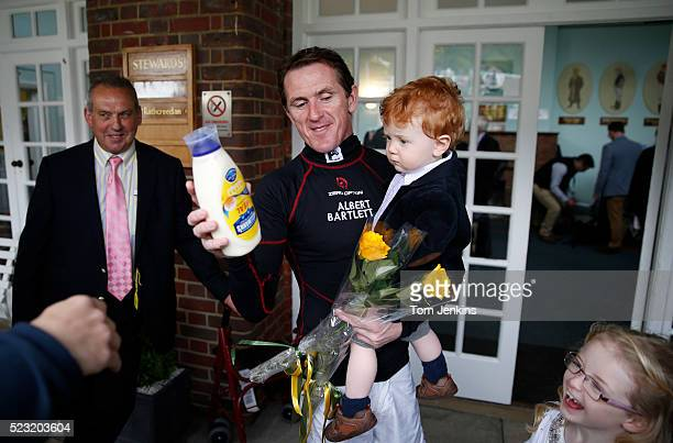 AP McCoy with his son Archie and daughter Eve outside the weighing room gets presented with flowers and mayonnaise before racing during AP McCoy's...