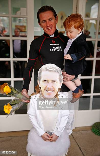 AP McCoy with his son Archie and daughter Eve wearing a mask outside the weighing room before racing during AP McCoy's final day of riding before...