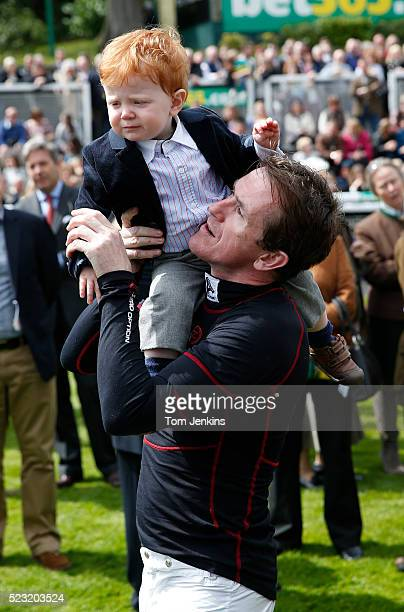 AP McCoy with his son Archie before racing during AP McCoy's final day of riding before retirement at Sandown Park racecourse on April 25th 2015 in...