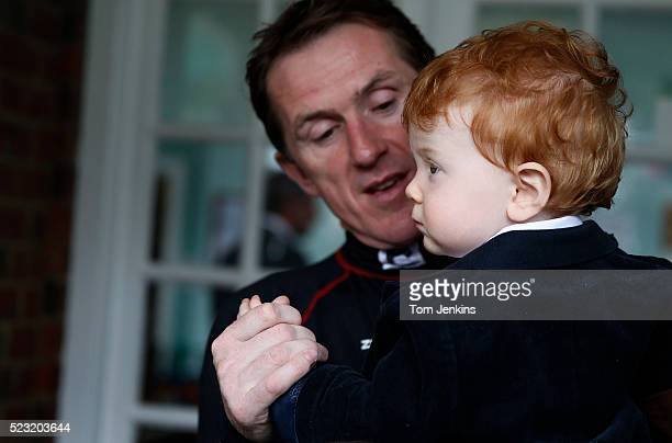 AP McCoy with his son Archie outside the weighing room before racing during AP McCoy's final day of riding before retirement at Sandown Park...
