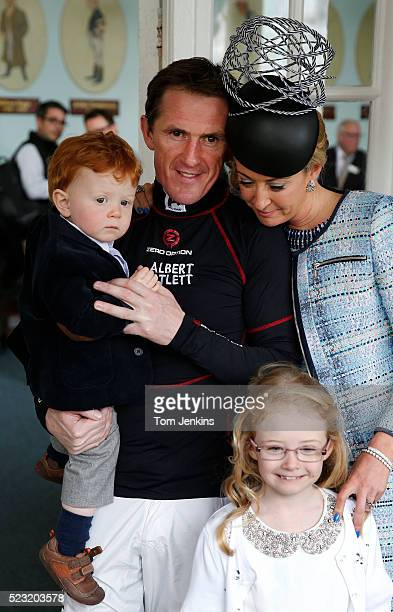 AP McCoy with his wife Chanelle son Archie and daughter Eve outside the weighing room before racing during AP McCoy's final day of riding before...