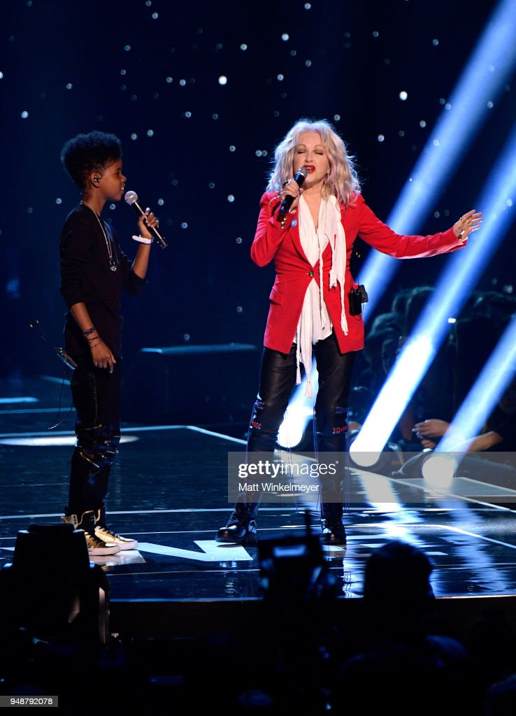 JD McCrary (L) and Cyndi Lauper perform onstage at WE Day California at The Forum on April 19, 2018 in Inglewood, California.