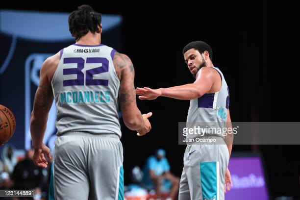 McDaniels high-fives Ray McCallum of the Greensboro Swarm during the game on February 28, 2021 at AdventHealth Arena in Orlando, Florida. NOTE TO...