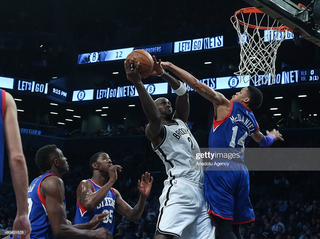KJ McDaniels #14 of Philadelphia 76ers vies with Kevin Garnett #2 of Brooklyn Nets during a basketball game at the Barclays Center on December 12, 2014 in the Brooklyn borough of New York, NY.