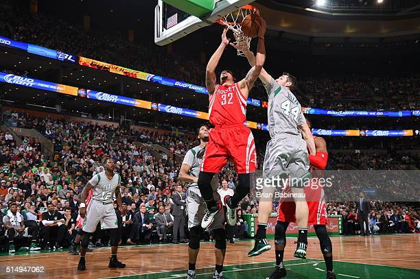 J McDaniels of the Houston Rockets shoots the ball against the Boston Celtics on March 11 2016 at the TD Garden in Boston Massachusetts NOTE TO USER...