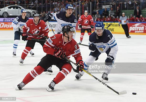 McDavid Connor of Canada vies with Lindell Esa of Finland during IIHF Ice Hockey World Championship gold medal match between Finland and Canada at...