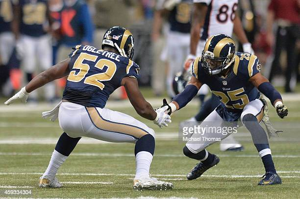 J McDonald and Alec Ogletree both of the St Louis Rams celebrate after an interception against the Denver Broncos at the Edward Jones Dome on...
