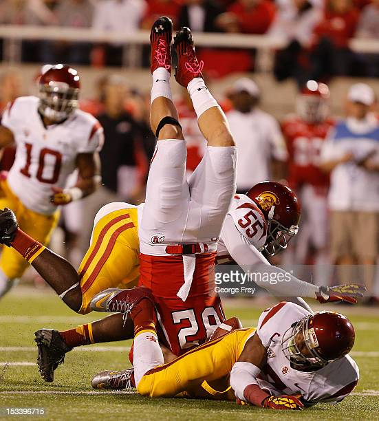 McDonald and Lamar Dawson of the USC Trojans upends Jake Murphy of the Utah Utes during the first half of a college football game October 4, 2012 at...