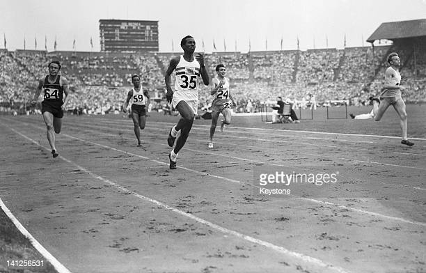McDonald Bailey of Great Britain wins heat 6 of the Men's 100 metres event at Wembley Stadium during the London Olympics 30th July 1948 Haukur...