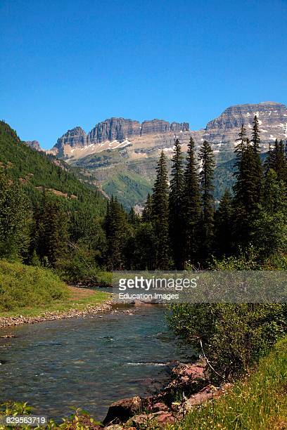McDonald Creek with the mountains of the Garden Wall in the background in Glacier National Park Montana in summer McDonald Creek flows into McDonald...