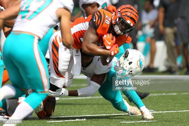 McDonald of the Miami Dolphins has his helmet knocked off while tackling Joe Mixon of the Cincinnati Bengals during the first quarter at Paul Brown...