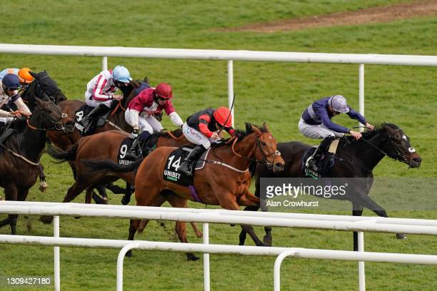 McDonald riding Artistic Rifles win The Unibet Spring Mile Handicap at Doncaster Racecourse on March 27, 2021 in Doncaster, England. Sporting venues...