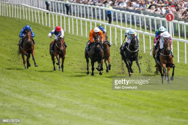 McDonald riding Cosmic Law win The Investec Woodcote EBF Stakes during the Investec Ladies Day at Epsom Downs Racecourse on June 1 2018 in Epsom...