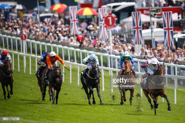 McDonald riding Cosmic Law wins The Investec Woodcote EBF Stakes during the Investec Ladies Day at Epsom Downs Racecourse on June 1 2018 in Epsom...