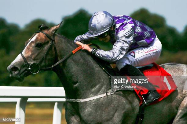 McDonald riding Havana Grey win The Allied World Dragon Stakes at Sandown Park racecourse on July 7 2017 in Esher England
