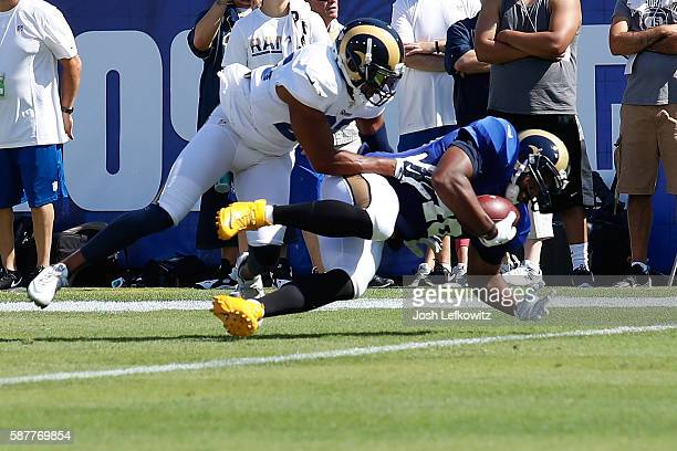 J McDonald tackles Justice Cunningham of the Los Angeles Rams during practice at the Los Angeles Coliseum on August 6 2016 in Los Angeles California