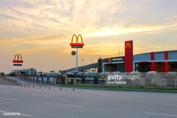 mcdonalds against sunset - mcdonald's stock pictures, royalty-free photos & images